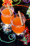Cranberry Wassail. 2 portions in glasses with cinnamon sticks Stock Images