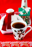 Cranberry Wassail. In a cup and handmade snowman on the background Stock Photo