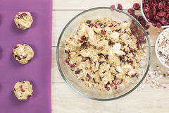 Cranberry and white chocolate cookies dough in bowl Stock Photo