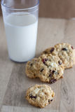 Cranberry White Chocolate Oatmeal Cookies. Oatmeal cookies with cranberries and white chocolate chunks on a wooden counter top Royalty Free Stock Photography