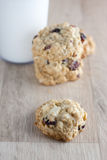 Cranberry White Chocolate Oatmeal Cookies. Oatmeal cookies with cranberries and white chocolate chunks on a wooden counter top Stock Photos