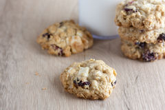 Cranberry White Chocolate Oatmeal Cookies. Oatmeal cookies with cranberries and white chocolate chunks on a wooden counter top Royalty Free Stock Photo
