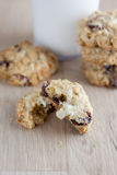 Cranberry White Chocolate Oatmeal Cookies. Oatmeal cookies with cranberries and white chocolate chunks on a wooden counter top Stock Photo