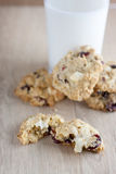 Cranberry White Chocolate Oatmeal Cookies. Oatmeal cookies with cranberries and white chocolate chunks on a wooden counter top Stock Photography