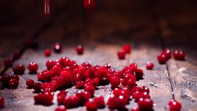 Cranberry on wooden background. Stock footage. Fresh red cranberries on the table. Healthy eating concept.  stock video