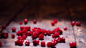 Cranberry on wooden background. Stock footage. Fresh red cranberries on the table. Healthy eating concept.  stock footage