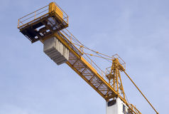 Crane-1. Yellow crane with blue sky in background Stock Image