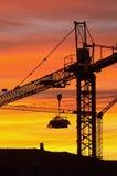 Crane. A crane on a construction site at sunrise Stock Image