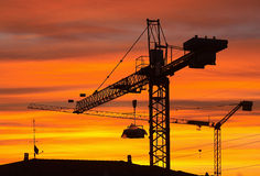 Crane. A crane on a construction site at sunrise Royalty Free Stock Images