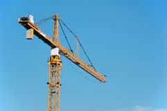 Crane. A big yellow crane in the sky Stock Image