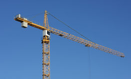 Crane. Yellow Crane with a blue sky stock image