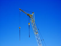 Crane. In blue summer sky Royalty Free Stock Images