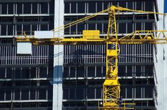 Crane. Yellow Crane in front of a building stock photography