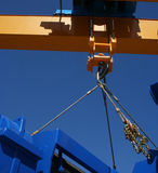 Crane. Big crane hook on the blue sky background Royalty Free Stock Photos
