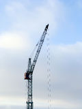 Crane. Single crane on blue sky background Royalty Free Stock Photography