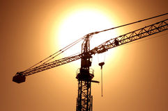 Crane. Sunset with crane Stock Image