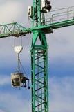 Crane. Green Crane picture over sky background. Construction area Stock Photo