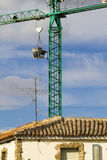 Crane. Green Crane picture over sky background. Construction area Royalty Free Stock Photo