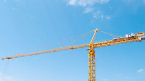Crane. On a background of blue sky Stock Photography