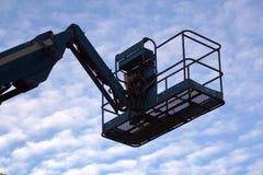 Crane. A working crane over blue sky Royalty Free Stock Photo