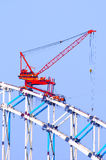 Crane. The working crane in the blue sky stock photography