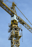 Crane-2. Yellow crane with blue sky in background Stock Photos