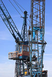 Crane. Photo of the cab and structure of an industrial crane. Clear blue sky behind Royalty Free Stock Photo