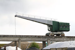Crane. An old green and grey crane used for loading and unloading ships at the harbour Royalty Free Stock Images