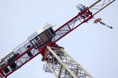Crane. Is working in a city center Stock Photos