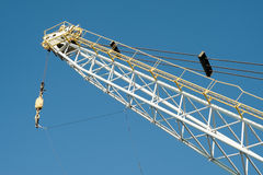 Crane. Dockyard cargo crane detail against a blue sky Royalty Free Stock Photography