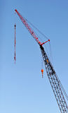 Crane. In the blue sky Royalty Free Stock Image