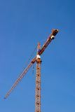 Crane. A heavy construction crane against a clear blue sky Royalty Free Stock Image