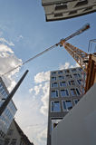 Crane. Yellow crane and buildings viewed from below Royalty Free Stock Image