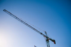 Crane. On the background of blue sky Royalty Free Stock Photography