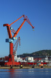 Crane. A dockside crane against a clear blue sky. Space for text in the sky Stock Photos