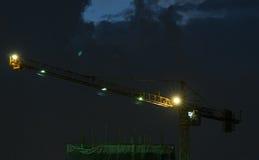 Crane. Industrial landscape. Construction cranes and concrete structure at sunset Stock Photography