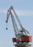 Crane. A crane on top of a building Royalty Free Stock Image