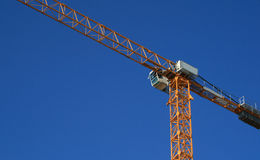 Crane. Yellow crane and blue sky Stock Photography
