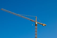 Crane. Against the blue sky Royalty Free Stock Photo