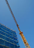 Crane. Wide angle shot of Crane and scaffolding - blue sky Stock Images