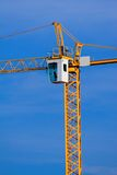 Crane. Yellow construction crane over a blue sky Royalty Free Stock Images