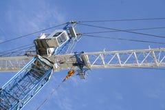 Crane. From underneath against blue sky Stock Photos