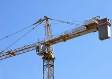 Crane. Closeup of a yellow crane against blue sky Stock Photography