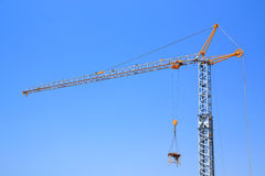 Crane. Industrial crane isolated on blue sky Royalty Free Stock Photo