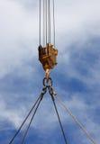 Crane. Close up of a crane hook lifting something Stock Photos