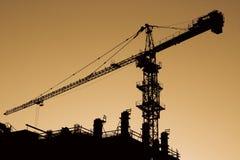 Crane. Silhouette of high crane at sunset Stock Image
