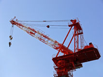 Crane. Red crane on top of a house stock photography