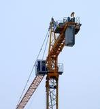 Crane. One crane against blue sky Stock Photo