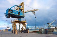 Crane. Dock equipment and boats Stock Photo
