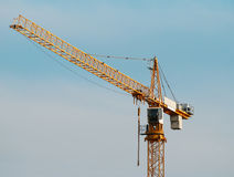 Crane. Building tower crane against the sky Royalty Free Stock Images